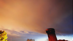 Very cool long-exposure timelapse night sky with chimney sparks Stock Footage