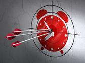 Stock Illustration of Timeline concept: arrows in Alarm Clock target on wall background