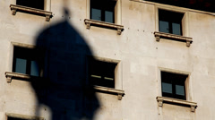 Shadow of tower moving along a facade Stock Footage