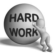 Stock Illustration of struggling uphill man with ball showing determination