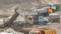 Dump trucks in the city dump Stock Footage