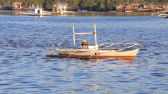 Motor boat with a man floats on the sea near the island of Coron, Philippines - stock footage