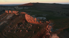 Aerial View: Flying over Aq-Qaya mount at sunset, Crimea Stock Footage