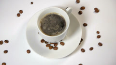 Coffee cup and beans on a white background. Stock Footage