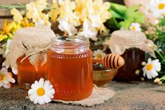 honey in a jar - stock photo