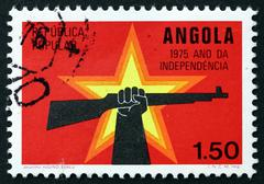 Postage stamp Portuguese Angola 1975 Star and Hand Holding Rifle - stock photo