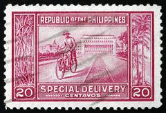 Postage stamp Philippines 1947 Manila Post Office and Messenger - stock photo