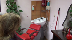 Zoom out head wash sink. barber dry client girl hair Stock Footage