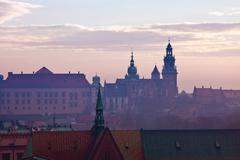 wawel hill with castle in krakow at sunset - stock photo