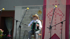 Senior folk musician perform with accordion stage city festival Stock Footage