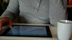 reading on digital tablet at coffee break - stock footage