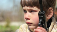 Stock Video Footage of Boy with gun,boy playing weapon,little warrior