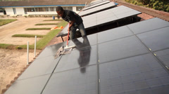 Stock Video Footage of Cleaning solar panels 2