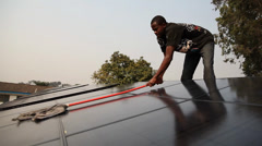Cleaning solar panels Stock Footage