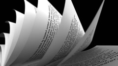 Close-up of rolled paper sheets on black background. Loopable. Stock Footage