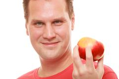 diet concept health care healthy nutrition. handsome man in red shirt holds a - stock photo