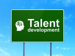 Education concept: Talent Development and Head With Finance Symbol on road sign Stock Illustration