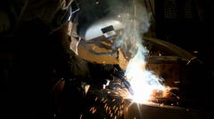 Soldering a piece of iron metal Stock Footage