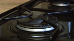 Ceramic gas hob igniting extreme close up Stock Footage