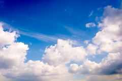 Fluffy white clouds Stock Photos