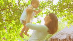 Mother and Baby Outdoors. Stock Footage