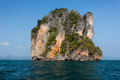 steep limestone island - stock photo