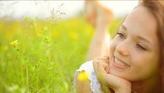 Girl lying on the Spring Meadow Stock Footage
