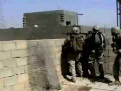 Iraq War - Soldiers battle insurgents - Gun battle with rooftop advantage Stock Footage