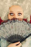 Surprised  Baroque Woman Monochrome Portrait with Wig and Fan Stock Photos