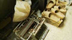 Old dusty typewriter next to box of clogs Stock Footage