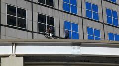 Building window maintenance Stock Footage
