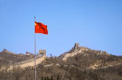The Chinese flag before The Great Wall of China - stock photo