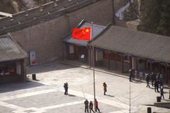 The Chinese flag outside The Great Wall of China - stock photo