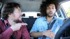 Two friends fighting in car about betrayal of girlfriend Stock Footage