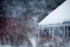 Icicles and Snowstorm Stock Photos