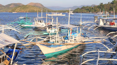 Motor boats floats on the sea in beautiful lagoon. Island Coron, Philippines - stock footage