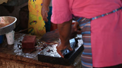 Woman cuts fish on the seafood market. Coron island, Philippines Stock Footage