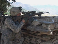 War in Afghanistan - Sharp Shooter rapid fire on enemy target - stock footage