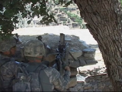 War in Afghanistan - Sharp Shooter rapid fire on enemy target Stock Footage