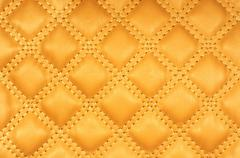 Sepia picture of genuine leather upholstery - stock illustration