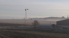 Fog patches over farm fields Stock Footage