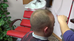 Closeup barber blow dry customer man hair in hairdresser salon Stock Footage