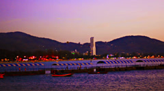 View of the embankment of patong from the sea in the evening Stock Footage