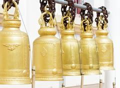 Old brass buddhist bell in temple. Stock Photos