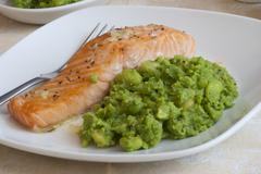 salmon with mushy peas - stock photo