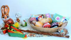 Easter decoration - basket of painted eggs and other decorations Stock Footage