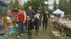 Friends visit Normandy car boot sale Stock Footage