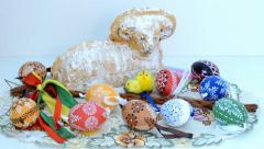 Easter decoration - ram to eat with painted eggs and other decorations Stock Footage