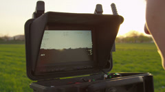 SLOW MOTION: Looking at live video while filming with a drone - stock footage