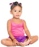 Multiracial small girl smiling sitting on the floor Stock Photos